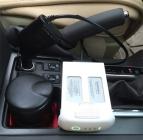 Chargeur allume-cigare pour DJI Phantom 4 branché à la prise d'un véhicule