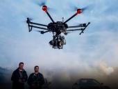 Nacelle main stabilisateur DJI Ronin-MX monté sous le drone matrice 600 et commandé par deux pilotes