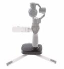 Couplez le support avec le trépied DJI Osmo afin de maintenir le steadycam sur toutes surfaces