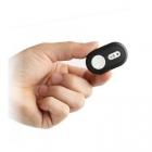 Télécommande Bluetooth pour caméra Xiaomi et iPhone tenue dans une main